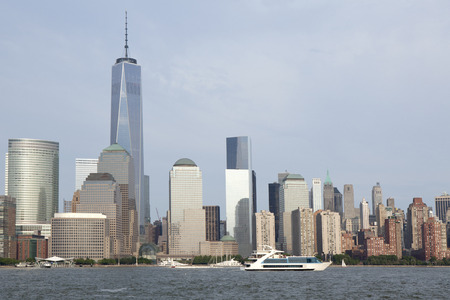 freedom tower: The Hudson river with Lower Manhattan in New York City in the background. The new World Trade Center Freedom Tower as seen  Summer 2014