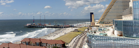 showboat: Panoramic view of the famous, Atlantic City boardwalk, beach, casinos and amusement pier  3 pictures were used to make this large panoramic image