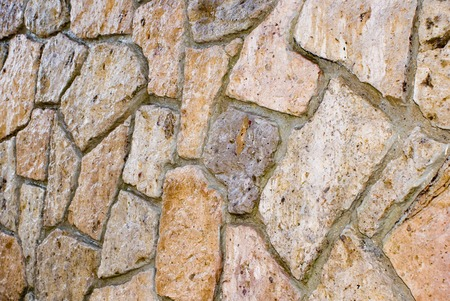 Stonework: random size of flat-face stone cut and stacked to make a wall. Texture and pattern background Stock fotó