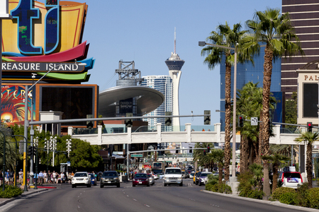 Look down the famous Las Vegas Blvd whic is known as The Strip showing the Treasure Island sign, Fashion Show Mall and the Stratosphere tower