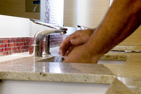Washing hands in Sink photo