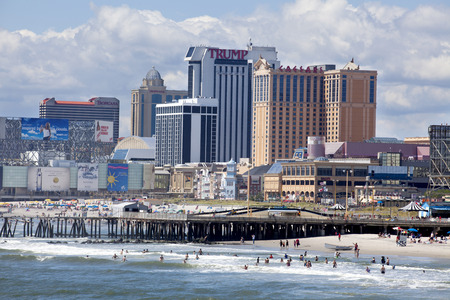 atlantic city: View of the beach, boardwalk and casinos along the ocean front of Atlantic City, New Jersey during anice summer day.