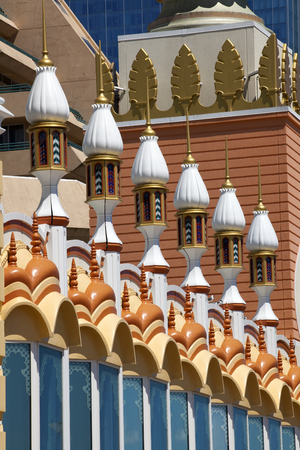 crown spire: Middle Eastern Architecture elements in the style of Mughal, Maratha and Rajput architecture found in India and the Middle east with Islamic conjectures of utilisation kiosks (chhatris, cenotaphs), tall towers (minars, minaret ) and half-domed double port