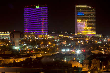Back bay and marina district of Atlantic City, New Jersey at night showing the Borgata Casino (left) and the Water Club Casino (right),