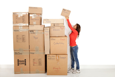 Woman stacking moving boxes