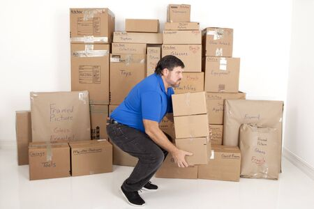 labeled: Man lifting a stack of moving boxes