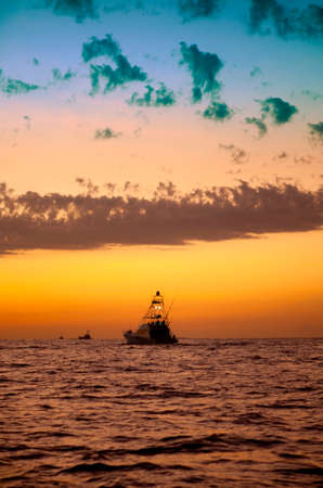 sport fishing: Sport fishing boats heading out just befor sunrise for a day of fishing.