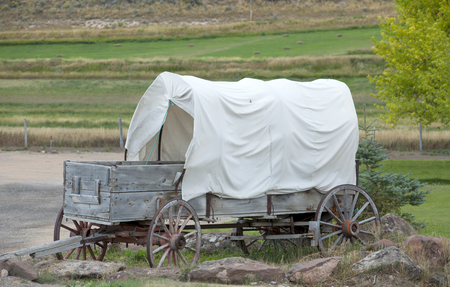 is covered: Old Covered Wagon Stock Photo