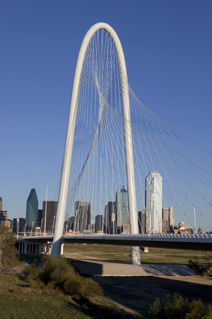 steel arch bridge: The new Margaret Hunt Hill Bridge that crosses the Trinity River in Dallas Texas. The bridge uses a unique design of a 400foot steel arch and cables to suport the bridge.