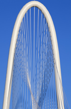 steel arch bridge: Architectural detail of the top of the new Margaret Hunt Hill Bridge that crosses the Trinity River in Dallas Texas. The bridge uses a unique design of a 400foot steel arch and cables to support the bridge.