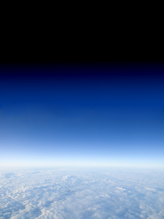 troposphere: From the cloudes to outer space.  A view at 40000 feet above the clouds with the sky fading to space. this area is known as the troposphere which begins at the surface and extends to between 9 km 30000 ft at the poles and 17 km 56000 ft at the equator
