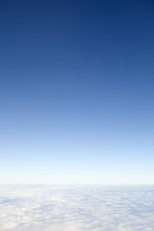 troposphere: A view at 40000 feet above the clouds with the sky fading to space. this area is known as the troposphere which begins at the surface and extends to between 9 km 30000 ft at the poles and 17 km 56000 ft at the equator