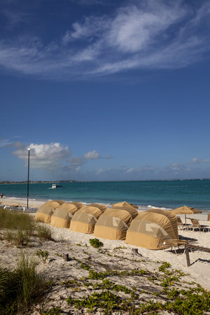 the turks: Line of beach cabanas overlooking the ocean in the Turks and Caicos Island