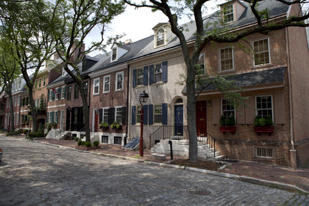 17th century: Historic Row Homes along cobble stone street in historic Old City in downtown Philadelphia Pennsylvania. Homes along this area are from the late 17th century to the early 19th century Editorial