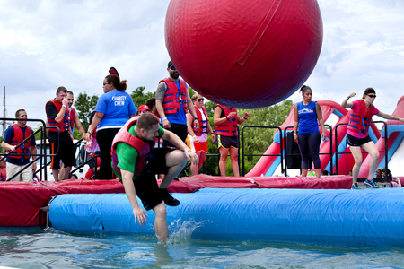 game show: Man falling at the wrecking balls water obstacle at the Wipeout 5K Run obstacles course in Wilmington Delaware The Wipeout Run is themed after the popular ABC game show Wipeout and has12 obstacles. Some of the obstacles incorporated in the course are