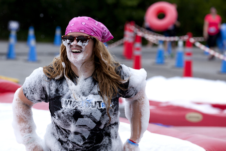 Woman covered with foam at the Foam of Fury obstacle at the Wipeout 5K Run obstacles course in Wilmington Delaware  The Wipeout Run is themed after the popular ABC game show Wipeout and has12 obstacles. Some of the obstacles incorporated in the course a