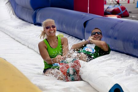 obstacle: Friends sliding happy endings waterslide obstacle at the finish of the Wipeout 5K Run obstacles course in Wilmington Delaware The Wipeout Run is themed after the popular ABC game show Wipeout and has12 obstacles. Some of the obstacles incorporated in