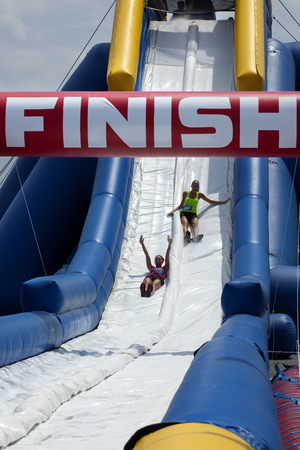 endings: Friends sliding happy endings waterslide obstacle at the finish of the Wipeout 5K Run obstacles course in Wilmington Delaware The Wipeout Run is themed after the popular ABC game show Wipeout and has12 obstacles. Some of the obstacles incorporated in