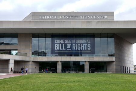 independance: Tourist sightseeing at National Constitution Center located on Independance mall in Philadelphia Pennsylvania where they can see the original Bill of Rights Editorial