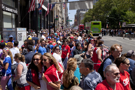 ticker: Crowds of fans of the USA womens soccer team fans line Broadways Canyon of Heroes during the ticker tape parade to celebrate the U.S. womens soccer team FIFA World Cup victory in downtown New York City