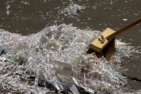 mess: Pieces of paper and streamers being swept up with a broom after the Ticket-tape Parade for the FIFA World Cup Champions US Women National Soccer Team ticker-tape parade in downtown New York City