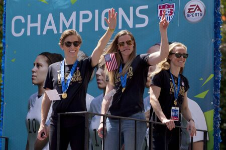 soccer world cup: U.S. womens soccer team wave to the crowd as their float makes it way up Broadways Canyon of Heroes during the ticker tape parade to celebrate the U.S. womens soccer team FIFA World Cup victory in downtown New York City Editorial