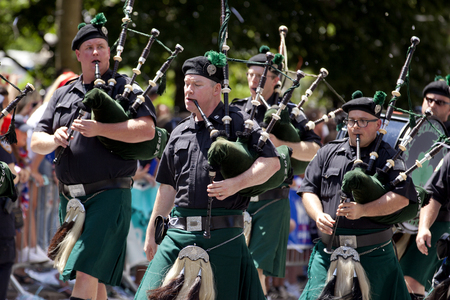 bagpipe: New York City Sanitation Department Bagpipe Marching Band peforming during the ticker-tape parade along Broadways Canyon of Heroes celebrating the FIFA World Cup Champions US Women National Soccer Team in downtown New York City