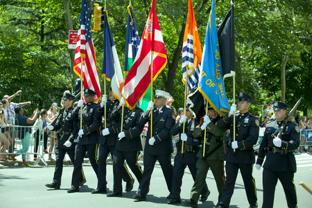usa flags: Members of the New York City Police and Fire Department Honor Guard marching up Broadways Canyon of Heroes during the ticker tape parade to celebrate the U.S. womens soccer team FIFA World Cup victory in downtown New York City