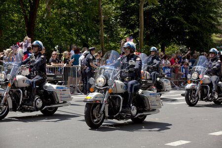 motorcycle officer: Members of the New York City Police Department Motorcycle squad drive up Broadways Canyon of Heroes during the ticker tape parade to celebrate the U.S. womens soccer team FIFA World Cup victory in downtown New York City