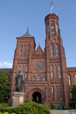 seneca: The facade of Smithsonian Castle in Washington, D.C. USA. The Smithsonian Castle houses the Smithsonian Institutions administrative offices and information center. The building is constructed of red Seneca sandstone and was designed in 1847 by architect  Editorial
