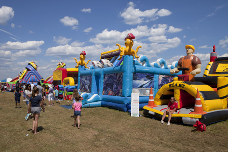 People enjoying some of the inflatable bounce houses, rides and activities at the New Jersey Ballooning Festival in Whitehouse Station, NJ