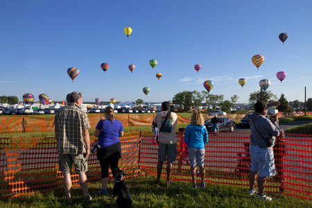 flight mode: The mass ascension launch of over 100 colorful hot air balloons at the New Jersey Ballooning Festival in Whitehouse Station, New Jersey as a early morning race.