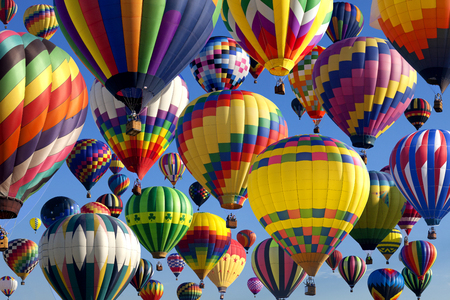 The mass ascension launch of over 100 colorful hot air balloons at the New Jersey Ballooning Festival in Whitehouse Station, New Jersey as a early morning race.