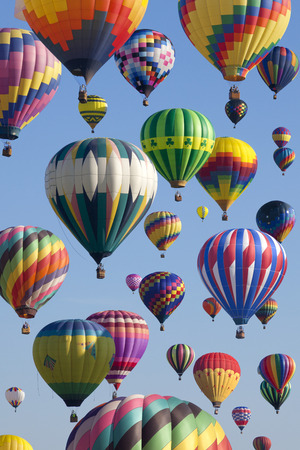 ballooning: The mass ascension launch of over 100 colorful hot air balloons at the New Jersey Ballooning Festival in Whitehouse Station, New Jersey as a early morning race.