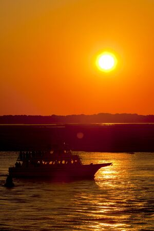 yachtsman: Sport fishing boats heading out just before sunset for a day of fishing. Stock Photo