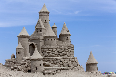 Sand Castle with blue background. Copy space