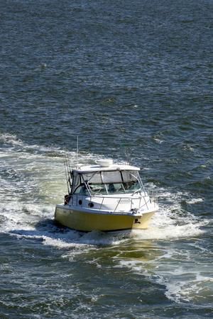 sport fishing: A sport fishing boat cruising in New Jersey. Stock Photo