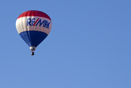 ReMax Balloon at New Jersey Ballooning Festival is one of the theme or specially balloons as part of the mass ascension launch of over 100 colorful hot air balloons during the festival in Whitehouse Station, New Jersey