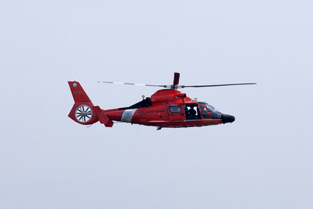 flyovers: US Coast Guard MH-65-C Dauphin Rescue helicopter preforming aerial maneuvers at the Atlantic City Airshow in New Jersey