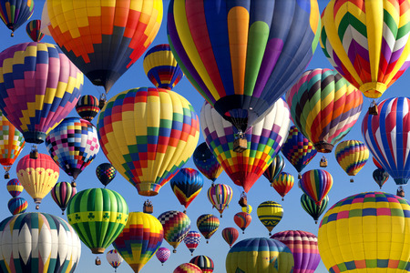 hot air: The mass ascension launch of over 100 colorful hot air balloons at the New Jersey Ballooning Festival in Whitehouse Station, New Jersey as a early morning race.