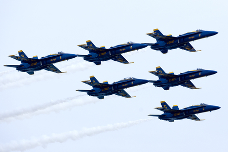 airshow: US Navy Blue Angels squadron flying preforming precision aerial maneuvers at the Atlantic City Airshow in New Jersey Editorial