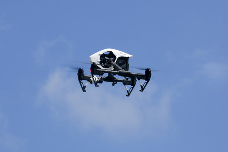 hobbyist: Quadrocopter drone flying in the sky
