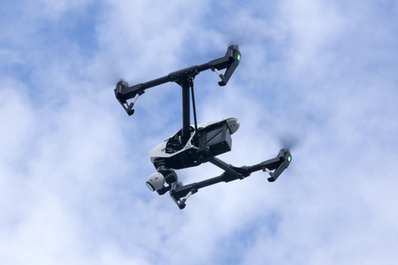 aerospace industry: Quadrocopter drone flying in the sky
