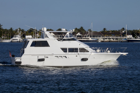 intercoastal: Luxury yatch in the intercoastal waterway with West Palm Beach, Florida in the background.