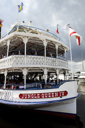charter: Birds-eye-view of the Jungle Queen taking s group of tourist on a charter sightseeing tourin Fort Lauderdale, Florida. The Jungle Queen offers tourist a fully narrated, 90-minute cruises along the Venice of America, Fort Lauderdales waterways. The cr Editorial