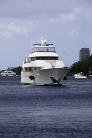 intercoastal: Luxury yatch in the intercoastal waterway with Fort Lauderdale, Florida in the background.