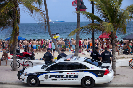 spring break: Police watching over students having a good time in Fort Lauderdale, Florida during spring break. Fort Lauderdale is a major vacation destination for college students during spring break and security and safity are a major concern for local communities.
