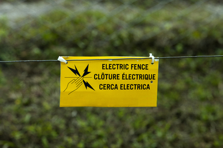 electric fence: Electric fence warning sign