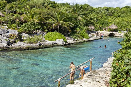 vacationing: People vacationing in Cancun Mexico, going snorkeling in a protected cove with clear water.