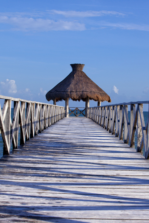 getting away from it all: Tropical pier that stretched out in to the crystal blue sea.